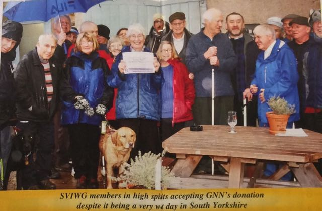 TSVIWG Members accept GNN Cheque